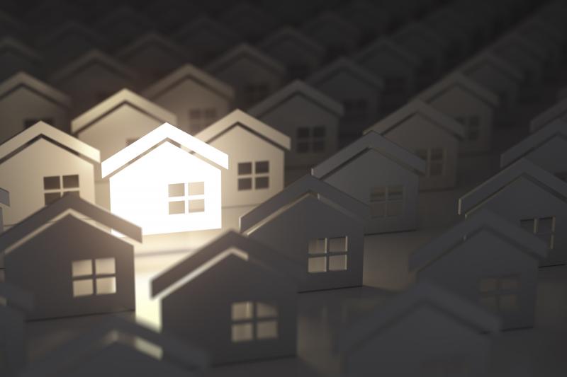 Illustration 3D de maisons identiques dont une seule est illuminée