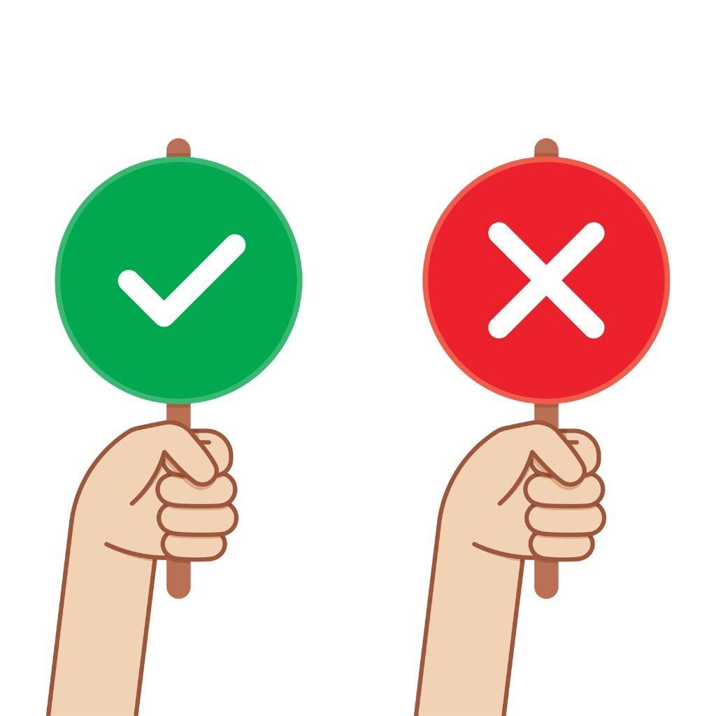 """Symbole de deux mains tenant des panneaux """"permission"""" et """"interdiction"""""""