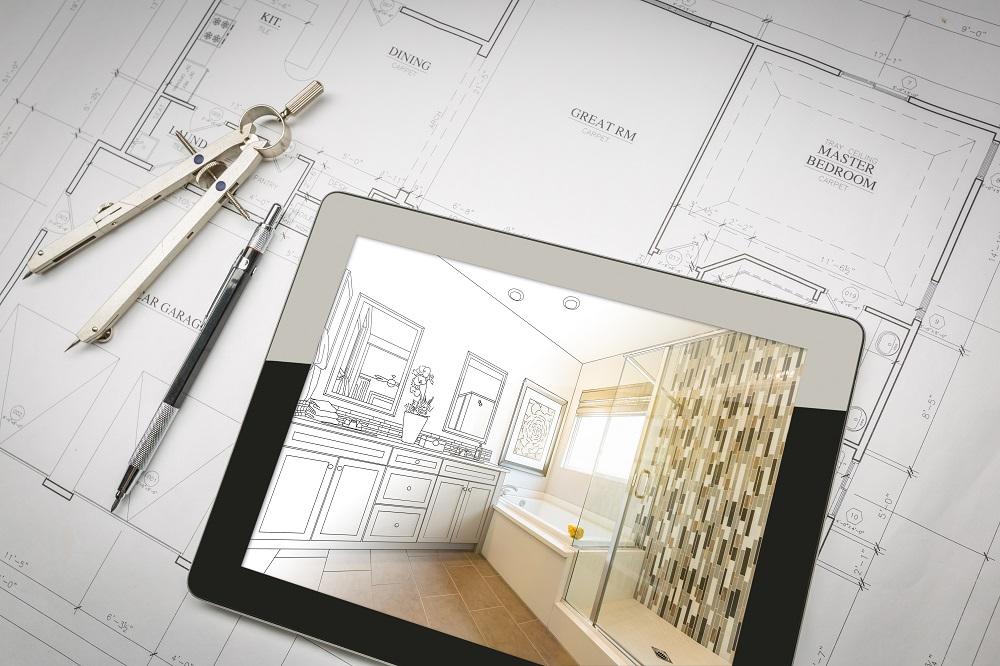 Plan de l'agencement d'une maison et projection sur tablette.
